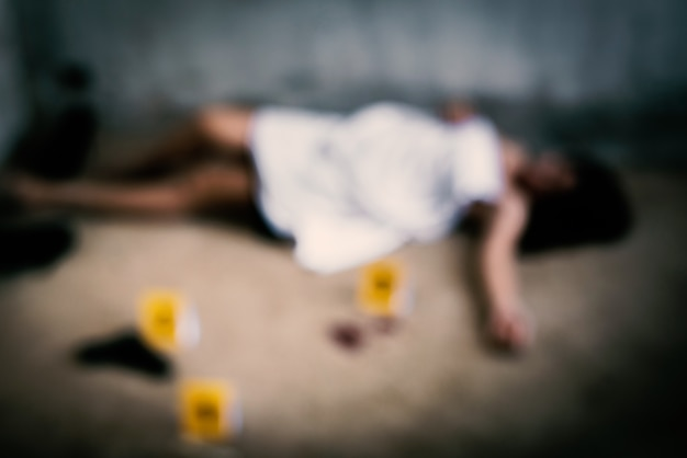 Blurry of woman corpse who was raped by thieve or robber in abandoned house Premium Photo