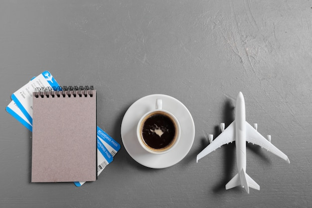 Boarding pass and toy airplane on table top view Premium Photo