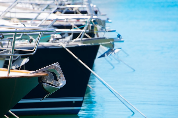Boat bow with anchor detail of sailboats in a row Premium Photo