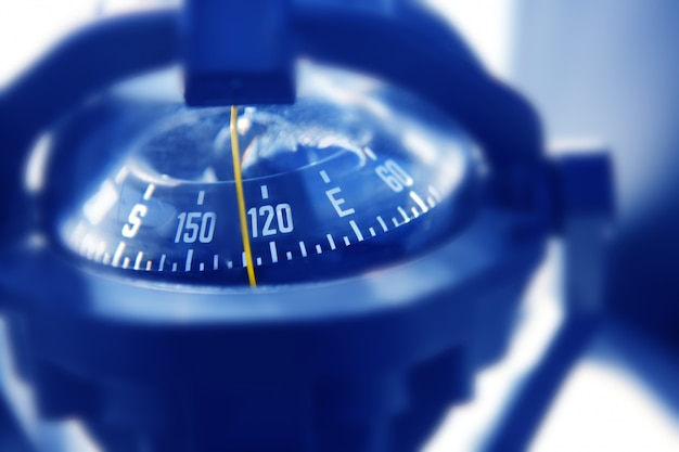 Boat marine compass in black blue light backlight Premium Photo
