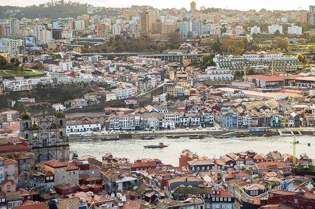 Boat on the river douro, view from above the city of porto in portugal Premium Photo