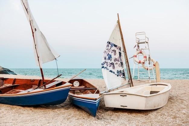 Boats on a beach Free Photo