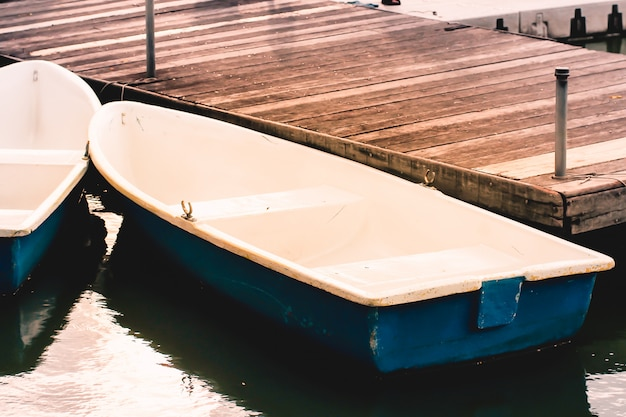 Boats at the wooden pier Premium Photo