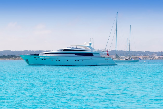 Boats yacht and sailboats anchor in formentera illetas Premium Photo