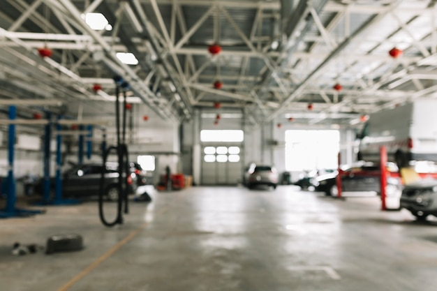 Body shop with cars in work Free Photo