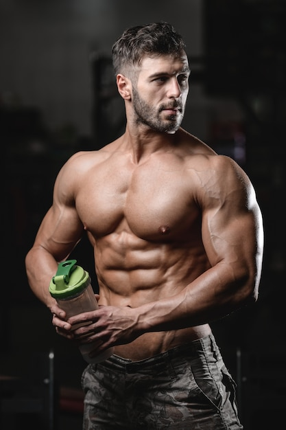 Bodybuilder Drinking Water After Workout Sport Muscular Fitness Man Cross Fitness And Bodybuilding Concept Gym Background Abs Muscle Exercises In Gym Naked Torso Fitness Concept Premium Photo
