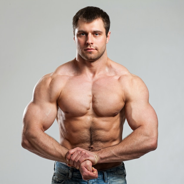 Bodybuilder shows his biceps Free Photo