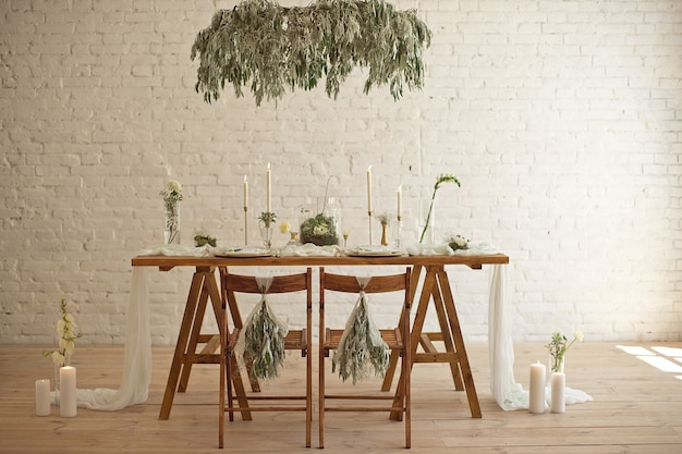 Boho wedding table setting, rustic decorations, gold and blue details, wooden table.luxury wedding decor. Premium Photo