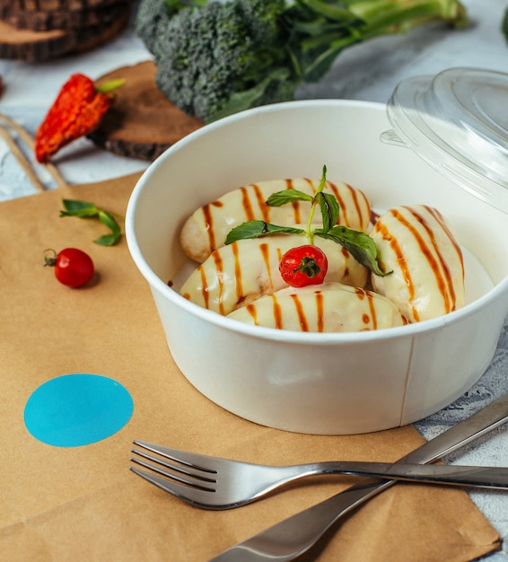 Boiled chicken fillet catlett delivery with dill, topped with cheese for healthy lunch Free Photo
