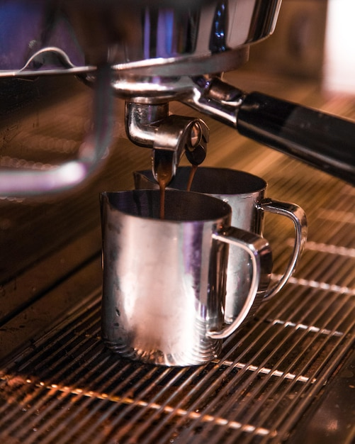Boiled coffee from coffee machine Free Photo