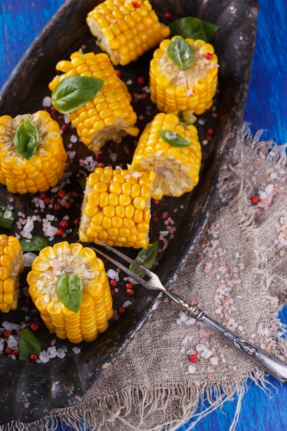 Boiled corn pieces with basil. snack on summer parties. Premium Photo