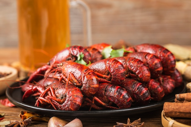 Boiled crayfish with beer on wooden Premium Photo