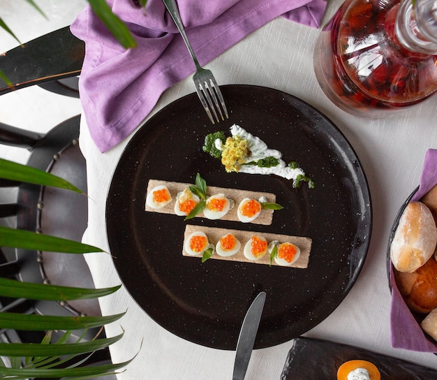 Boiled eggs with orange caviar Free Photo