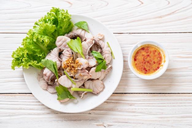 Boiled fish dip with sauce Premium Photo