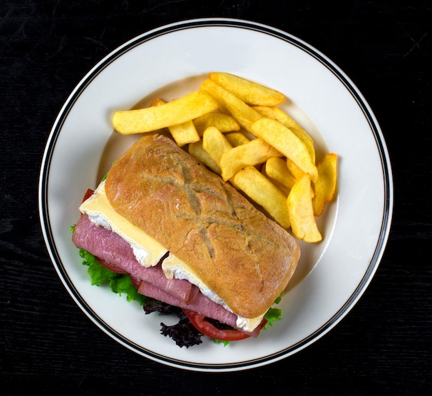 Boiled pork sandwich and french fries Free Photo