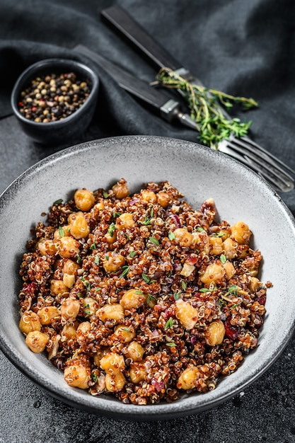 Boiled quinoa with chickpeas. healthy food, diet. black background. top view. Premium Photo