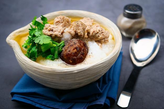 Boiled rice with minced pork, shiitake mushrooms Premium Photo