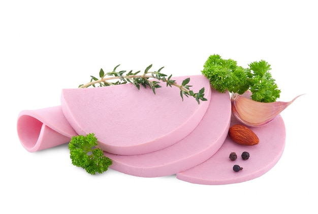 Boiled sausage sliced with salad and garlic isolated on white Premium Photo