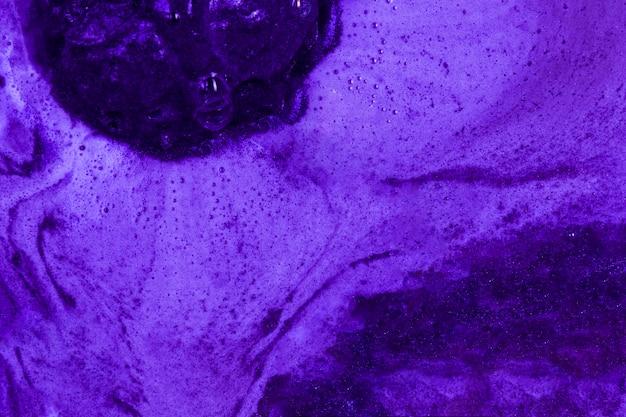 Boiling purple liquid with foam Free Photo