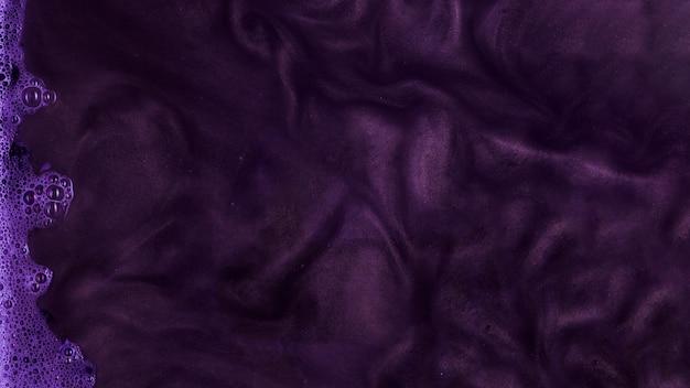 Boiling purple stiff paint with foam Free Photo