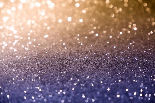 Звезды голубого и желтого конспекта текстуры предпосылки bokeh рождества светлые блестящие на bokeh. фон старинные огни блеск Premium Фотографии