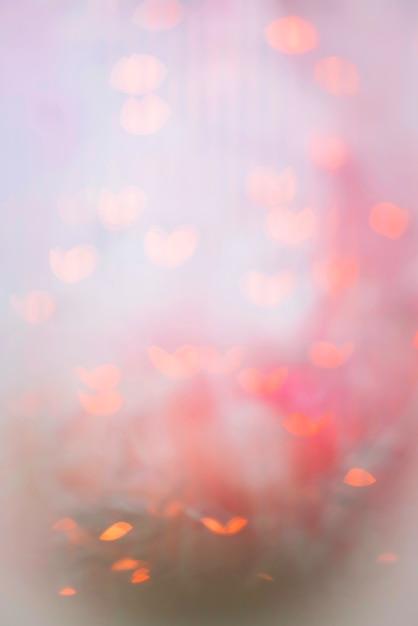 抽象的なbokeh背景のピンクの輝き 無料写真