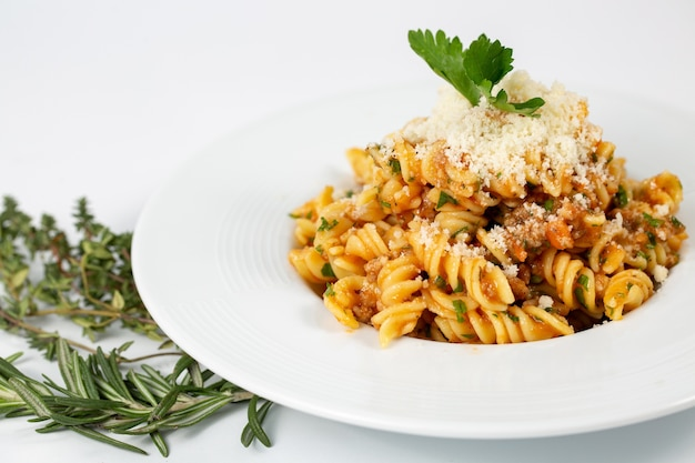 Bolognese pasta with parmesan Free Photo