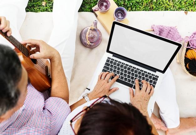 Bonding chilling couple music computer relax concept Premium Photo