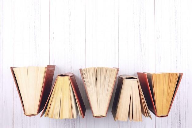 Book background. top view of open hardback books Premium Photo