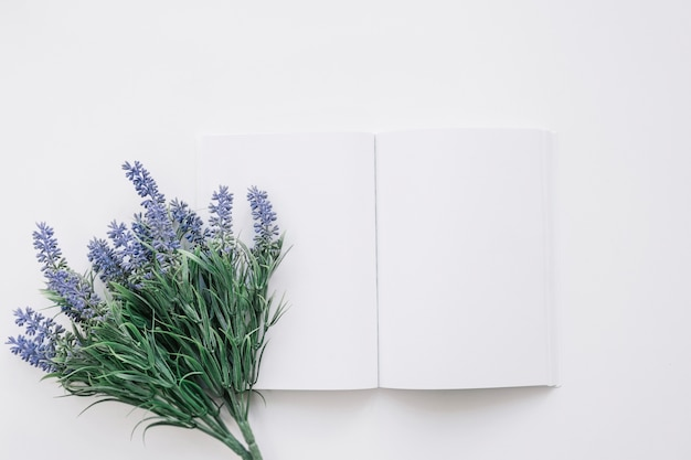 Book cover mockup with flower on left Free Photo