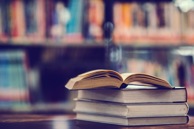 Book in library with open textbook Free Photo