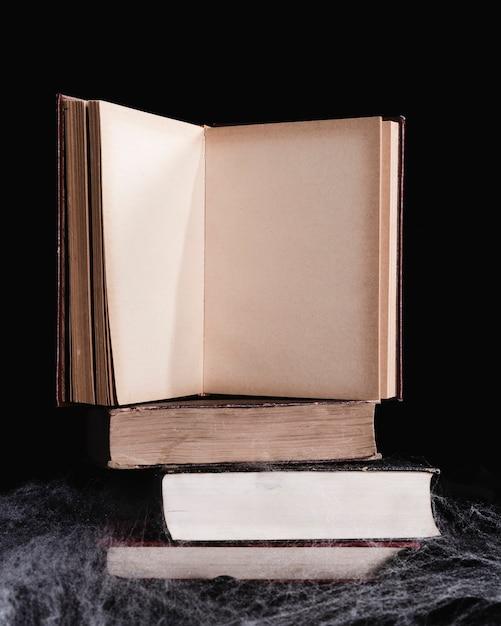 Book mock-up on black background Free Photo