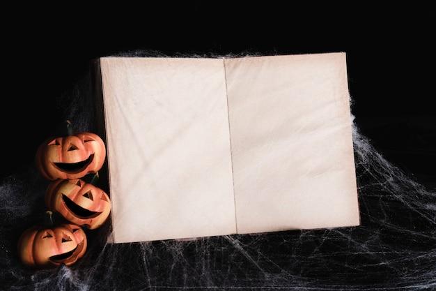 Book mock-up with jack-o'-lanterns Free Photo