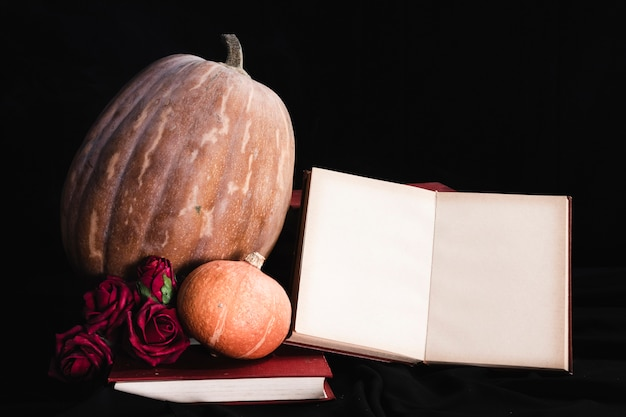 Book mock-up with pumpkins and roses Free Photo