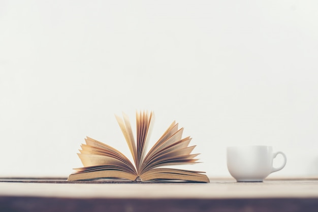 Book turning pages and a cup Free Photo