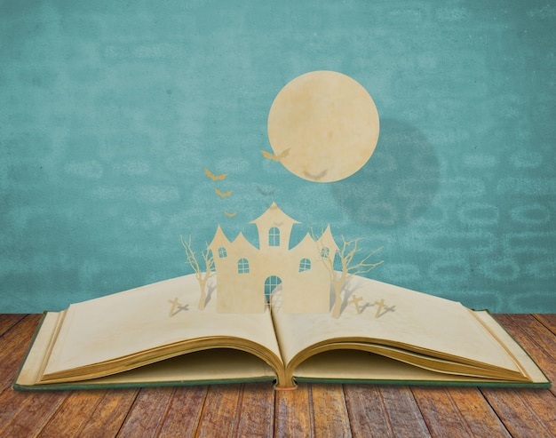 Book with a cutout and a sun on top of paper Free Photo