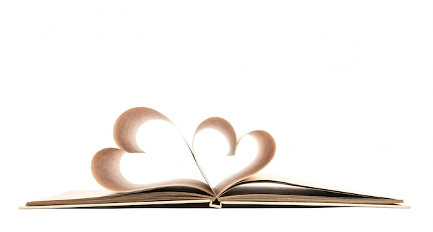 Book with opened pages of shape of heart isolated on white backg Free Photo