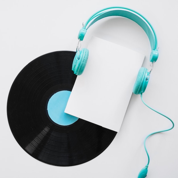 Booklet mockup with headphones and vinyl Free Photo