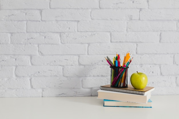 books apple and pencils on the table photo free download