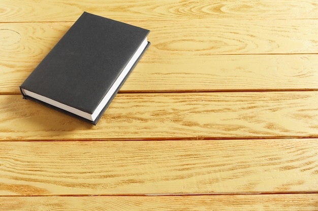 Books on the old wooden table Premium Photo