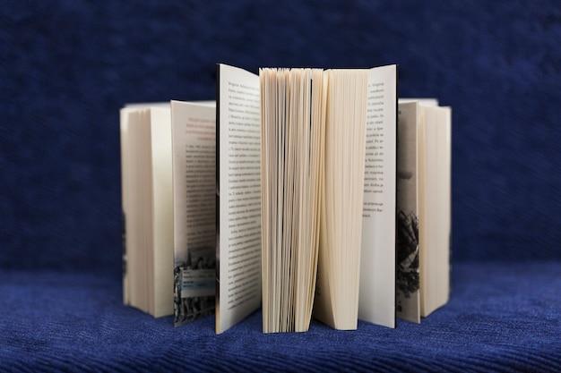 Books on blue background Free Photo