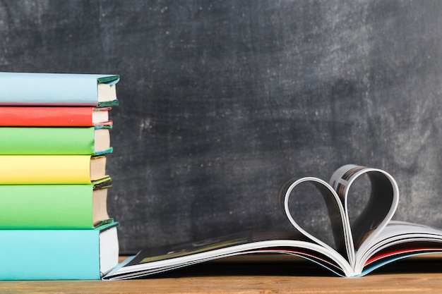 Books and pages in shape of heart Free Photo