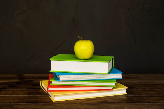 Books Pile With Apple On Top Free Photo