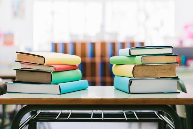 Books on school desk in class Free Photo
