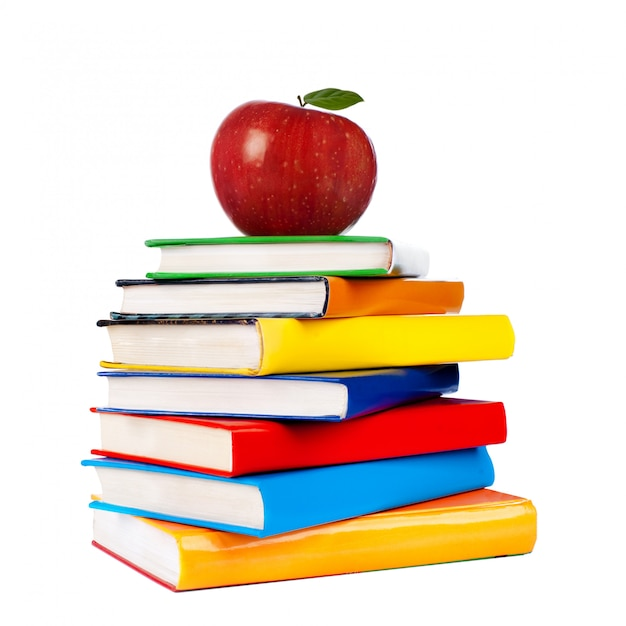 Books tower with apple isolated on white Premium Photo