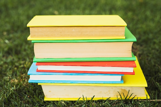 Books with blank bright covers on grass Free Photo