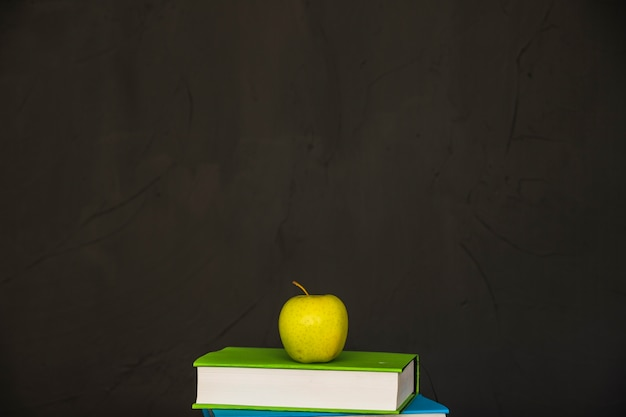 Books With Green Apple On Top Free Photo