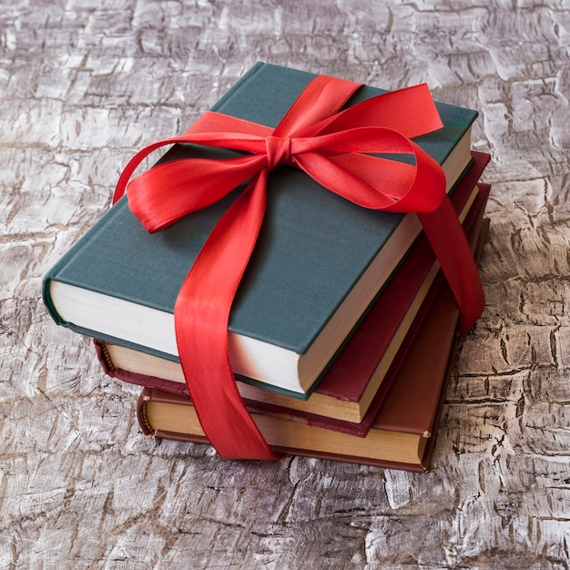 Books with red bow Free Photo