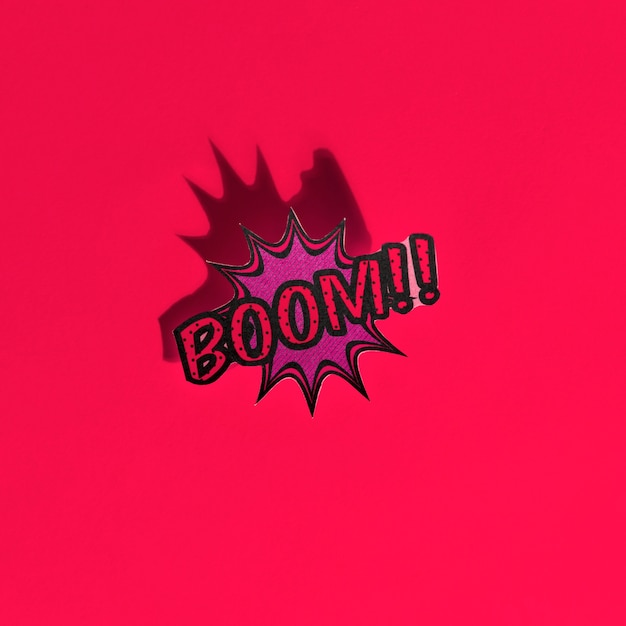 Boom comic text speech bubble pop art style sound effect on red