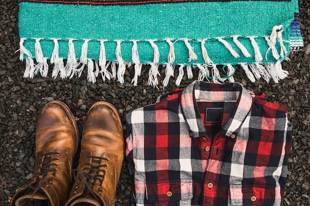 Boots and shirt near blanket Free Photo